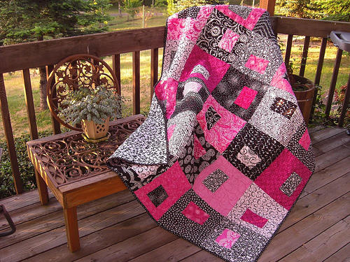 Putting on the Pink Quilt by Quiltsalad on Flickr